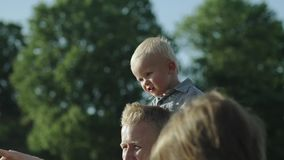 Portraits of little boys and parents on the bridge looking at the river slow motion Full HD