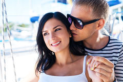 Portraits of a lovely couple relaxing on a boat Royalty Free Stock Photo