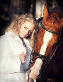 Portraits of nice bride with horse at evening Stock Photos