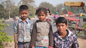Delhi, India - November 28, 2018: Portraits of poor children working and begging on the streets of Delhi.