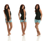 Portraits of Brunette. Posing with Black Shirt & Blue Shorts royalty free stock image