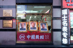 Portraits of three famous Chinese politicians in shop window on famous Wangfujing Street in central Beijing stock photos