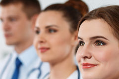 Portraits of three medics standing one by one Royalty Free Stock Photo