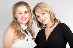 Portraits of two beautiful girls. Photographing of two nice girls royalty free stock photo