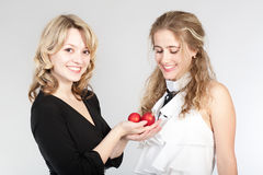 Portraits of two beautiful girls. Photographing of two nice girls stock photo
