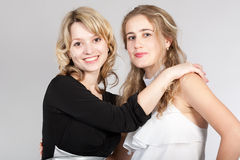 Portraits of two beautiful girls. Photographing of two nice girls stock photos