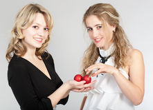 Portraits of two beautiful girls. Photographing of two nice girls stock image