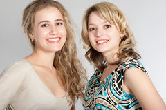 Portraits of two beautiful girls Stock Images