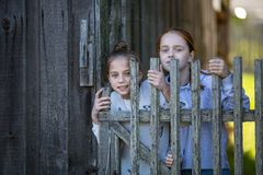 Portraits of two girls friends in village outdoors. Fun. stock image