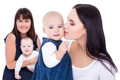 Portraits of two happy young mothers with little kids isolated on white royalty free stock photography