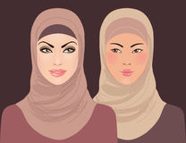 Portraits of two muslim beautiful girls in hijab Stock Photos