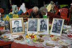 Portraits of veterans in frames put on a table. Stock Photo