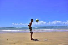 Portraits of the world. Alagoas. Brazil. Boy playing soccer on the beach of Peba, city of Piaçabuçu, state of Alagoas Brazil Stock Images