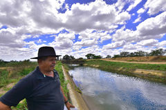 Portraits of the world. Alagoas. Brazil. Native of the town of Tapera, obersando canal that takes water to the town. New Church City, State of Alagoas Brazil Stock Images