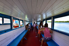 Portraits of the world. Alagoas. Brazil. Passengers in boat Tourists and natives, towards the city of Neopolis, state of Sergipe, Brazil Stock Photo