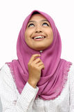 Portraits of young muslim woman looking upstairs. In white background Stock Photography