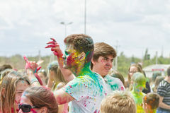 Portraits of young people with different colors smeared faces. VOLGOGRAD - JUNE 12: Portraits of young people participating in the festival of colors with Stock Image