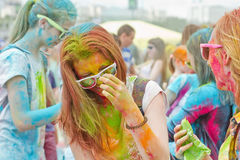 Portraits of young people with different colors smeared faces. VOLGOGRAD - JUNE 12: Portraits of young people participating in the festival of colors with Stock Photos