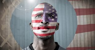 Portraiture of man with american flag against blurry wood panel with hand drawn american flag and fl. Digital composite of Portraiture of man with american flag stock image