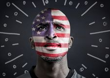 Portraiture of man with american flag face paint against navy chalkboard and white fireworks doodle. Digital composite of Portraiture of man with american flag Stock Images