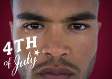 Portraiture of man with white fourth of July graphic against maroon background Stock Image