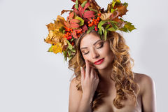 Portraiture style fashion beautiful sexy girl with red hair fall with a wreath of colored leaves and mountain ash color bright tre Royalty Free Stock Photos