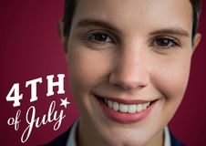 Portraiture of woman with white fourth of July graphic against maroon background Royalty Free Stock Photo