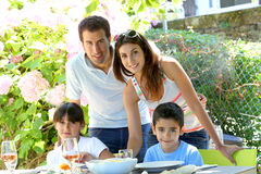 Portraot of happy family eating together in garden Stock Image