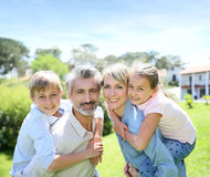 Portraot of happy family in the garden Stock Photo