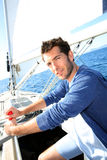 Portraot of man on a sailing boat Royalty Free Stock Image