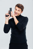 Portrat of cheerful young man with gun Stock Photos