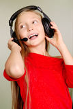 portrat delle cuffie della ragazza Fotografia Stock