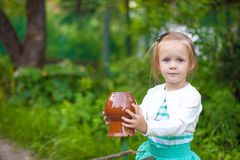 Portrat of little girl standing near vintage Royalty Free Stock Image