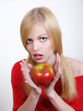 Portrate of beautiful girl with the apple. In her hands Stock Image