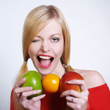 Portrate of beautiful girl with the fruits. Portrait of beautiful girl with the fruits in her hands Royalty Free Stock Photos