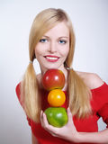 Portrate of beautiful girl with the fruits. In her hands Royalty Free Stock Images