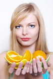 Portrate of beautiful girl with oranges. Portrate of beautiful girl with the big bright oranges Stock Images