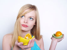 Portrate of beautiful girl with oranges. Portrate of beautiful girl with the big bright oranges Stock Image