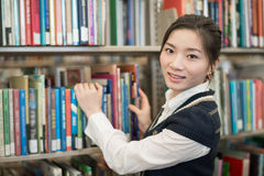 Portrati of student in front of bookshelf Stock Image