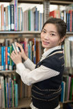 Portrati of student in front of bookshelf Stock Photography