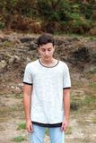 Portratif of a sad teenager guy. In the countryside Royalty Free Stock Photos