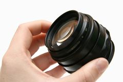 Portray russian old lens in hand Stock Photography