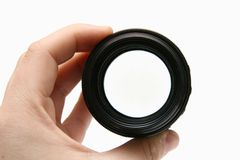 Portray russian old lens in hand Royalty Free Stock Image