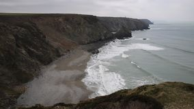 Portreath beach North Cornwall England UK. Between St Agnes and Godrevy on the Heritage Coast from headland looking away from town stock video footage