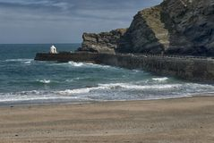 Portreath Pier at Portreath, Cornwall UK. Portreath is a civil parish, village and fishing port on the north coast of Cornwall, United Kingdom. The village is stock photo