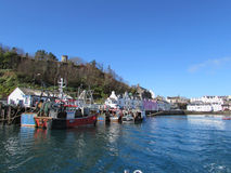 Portree, Isle of Skye, Scotland. Fishing boats in the harbour at Portree on the Isle of Skye, Scotland on a beautiful spring morning Stock Image