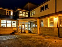 Portree, Isle of Skye , Scotland - October 25 2019 : Portree hospital is enlightened during the night stock photography