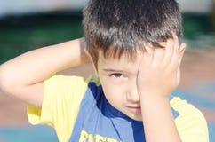 Portreit of a little boy. Portreit a little boy rubbing his eyelid Stock Photography