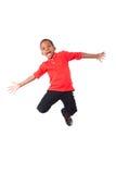 Portret śliczny amerykanin afrykańskiego pochodzenia chłopiec doskakiwanie, odizolowywający Fotografia Stock