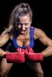 Portret agresywny żeński wojownik napina mięśnie Zdjęcia Royalty Free